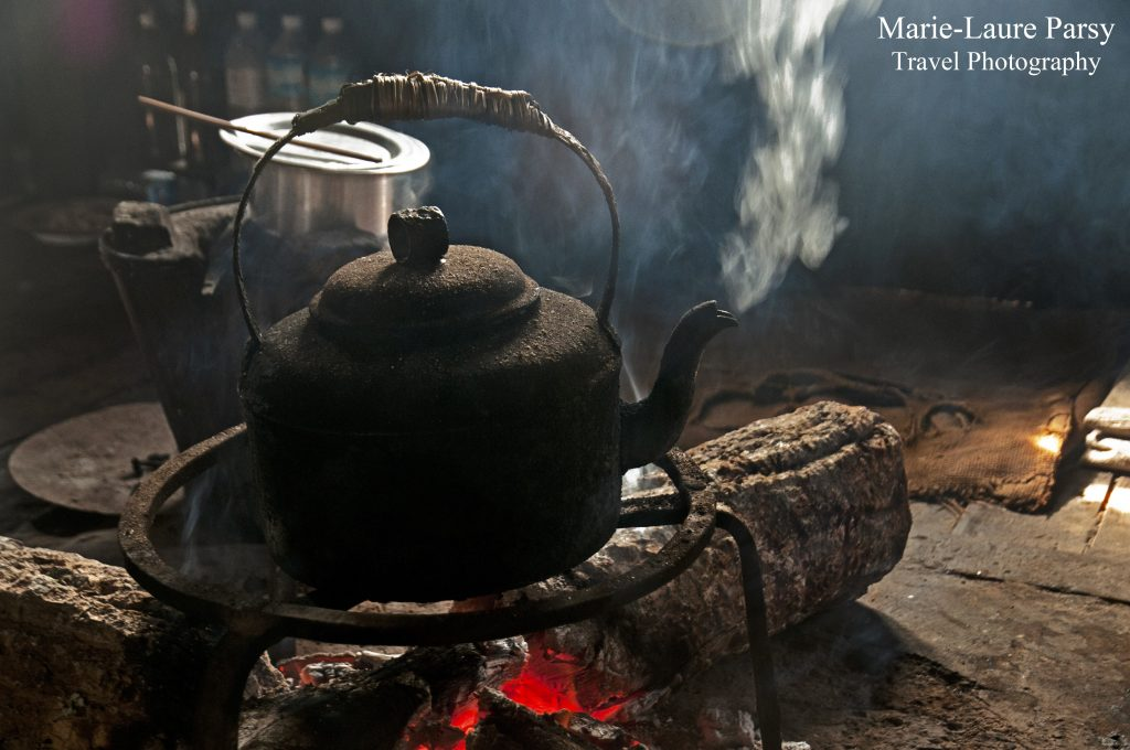As our guide explains the local customs and the turbulence of Northern Shan recent history, our tea for the evening slowly brews in a heavy pot of cast iron.
