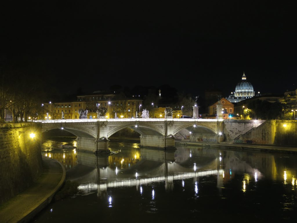 Crossing Ponte Sant'Angelo, one sees St. Peter's Basilica in the distance.
