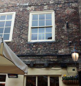 Original beam showing carpenter's marks at 71 Saddler Street