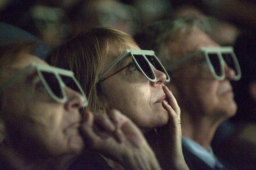 Unidentified people look at Imax 3D footage filmed by the Astronauts during the STS-125 Hubble Repair Mission through glasses Wednesday evening, Sept. 9, 2009, during a celebration of the Hubble Legacy at the National Air and Space Museum in Washington. Astronomers declared the telescope a fully rejuvenated observatory with the release Wednesday of observations from four of its six operating science instruments. Photo Credit: (NASA/Bill Ingalls)