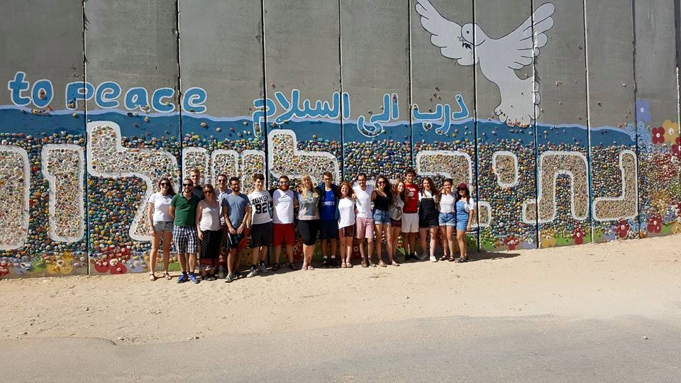 Young Yachad activists visit a peace mural on the Israel/Gaza border during the Yachad Student Trip to Israel and the occupied Palestinian territories.