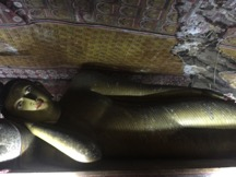 Reclining 'Nirvana' Buddha, in Damballa Caves, Sri Lanka. Author's Own Image.